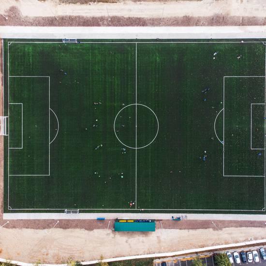 Будівництво <strong>футбольного поля</strong> зі штучним покриттям